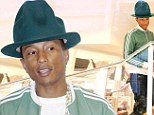 Pharrell in green hat