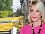 EXCLUSIVE: Tori Spelling starts production on new show as moving van comes to her house... on eve of husband Dean McDermott's release from rehab