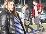 Heavily pregnant Drew Barrymore takes a stroll with close pal Jimmy Fallon and their families after celebrating her 39th birthday together