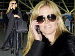 Touchdown! Heidi Klum turns baggage claim into a catwalk in sexy leather pants
