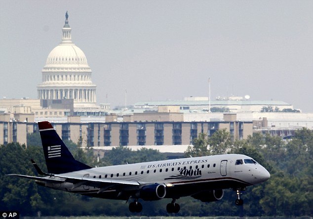 Close call: The three U.S. Airways jets were carrying a total of 192 passengers. Pictured, a flight arrives at the airport, which serves Washington D.C., on Thursday