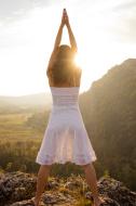 Raising arms to greet the sun