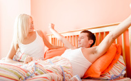 Couple Waking Up in Bed