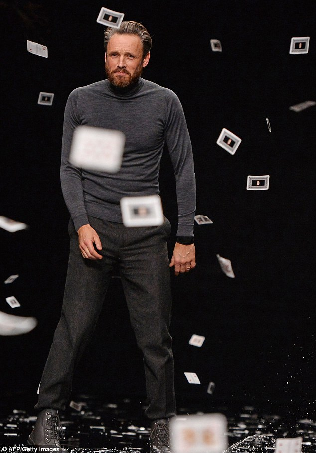 Job well done: Alasdhair Willis greets the crowd following his debut show as Dynamo sent hundreds of playing cards cascading