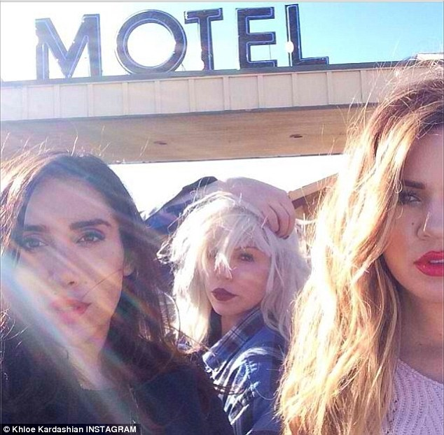 Photoshoot: Khloe who has been having marital woes posted a picture of herself onset with her friend and make-up artist