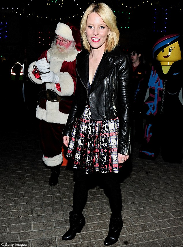 Sparkling: Elizabeth Banks showed her flair for winter style in an artsy plaid skirt and leather jacket at the annual LEGOLAND tree lighting ceremony in Carlsbad, California on Friday
