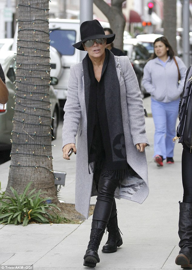 Undercover: Kris Jenner covers up with a fedora hat and reflective shades as she goes shopping in Beverly Hills