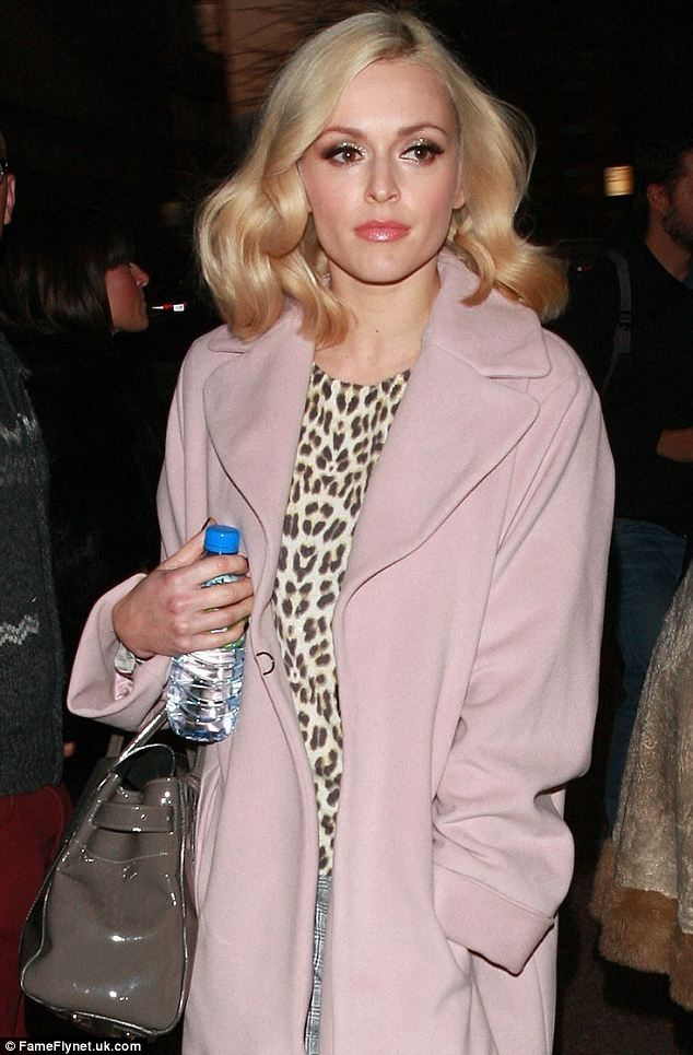 Glowing: Fearne wore false eyelashes for a retro look and went for shimmering eye makeup