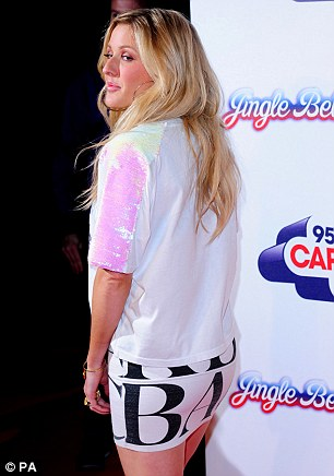 Tie-dye for: Ellie wore a T-shirt with her tight skirt that showed off her legs