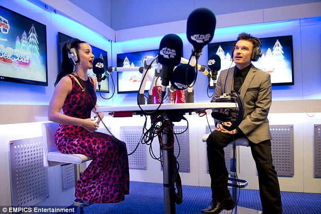 On air: Katy Perry is interviewed by presenter Greg Burns backstage at the Capital FM Jingle Bell Ball