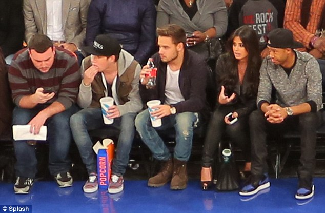 In good company: Niall and Liam were joined by stunning TV producer Nicole Isaacs (second from right) and her boyfriend Terrance J (far right)