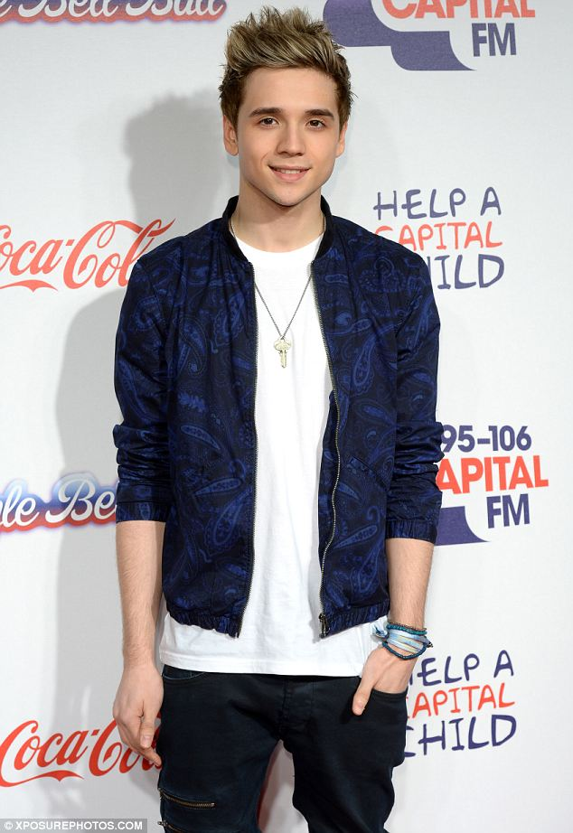 Feeling blue: Elyar Fox opted for a bright blue patterned baseball jacket