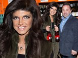 Wine time: Joe and Teresa Giudice hosted a wine bottle signing and tasting on Saturday in New Jersey ahead of their expected plea dea on federal fraud charges