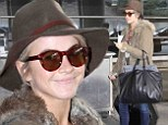 All smiles: Hough looked relaxed and happy at the airport