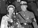 The ultimate goal: Standartenfuehrer Richard Fiedler during his wedding ceremony with Ursula Flamm in 1936, was attended by Joseph Goebbels, pictured behind the happy couple