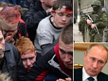 Clashes: Wounded protesters could be seen in Ukraine as Vladimir Putin gained approval to deploy troops in the coutry