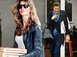 They even make rain look good! Supermodels Gisele Bundchen and Helena Christensen did battle with the wet stuff and still managed to shine