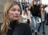 Model day-care: Kate Moss wears ripped stone-washed jeans as she takes daughter Lila Grace to Paris Fashion Week