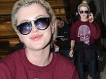 Quite the cool traveller! Ireland Baldwin looks casual chic in retro styled sunglasses as she makes her arrival at LAX