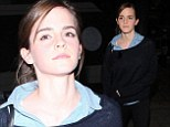 Emma Watson rocks schoolgirl chic as she touches down at LAX days before glamming up to take to the stage as a presenter at Sunday's Oscars