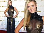 Sheer appeal! Joanna Krupa sizzles in cleavage-baring black and gold-embellished gown at pre-Oscar bash
