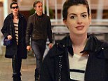 Love is always in style! Anne Hathaway flirts with fashion in leather pants on a dinner date with husband Adam Shulman