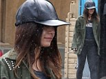 It's raining, it's pouring: Vanessa Hudgens was seen walking in the rain without an umbrella on Friday