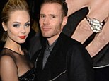 Engaged? Smallville's Laura Vandervoort 'accepted proposal from Oliver Trevena'... as she steps out with huge rock at Oscar party