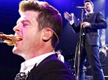 'She's a good woman': An emotional Robin Thicke dedicates song to Paula Patton during first concert since split... and wears his wedding ring