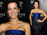 Busted! Kate Beckinsale enjoys a solo night out on the town as she shows off her cleavage in tight fitting bustier