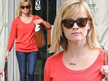 Keeping it casual: The actress wore an orange sweater and blue jeans on Thursday