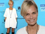 'I put a man in his place!' Kristin Chenoweth proudly proclaims her 'tiny win' as she attends pre-Oscars event in white mini-dress
