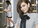 Eva Mendes does Sixties chic in a pussybow polka dot shift dress for dinner honouring Elizabeth Taylor