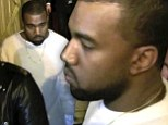 Kanye West guards his sweater as fans mob him with magic markers in Paris