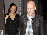 Protective: Bruce Willis kept a tight grip of wife Emma Heming as the pair enjoyed a romantic date night at Crossroads restaurant in West Hollywood on Thursday evening