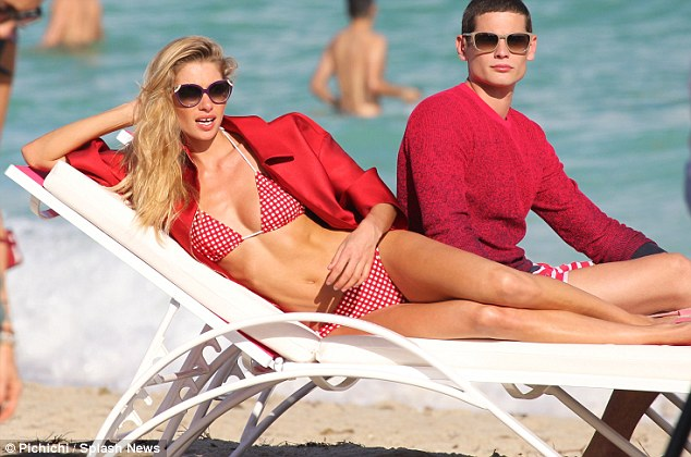Just lounging: Jessica clearly loves her job as she kicked back and relaxed in a red polka dot bikini
