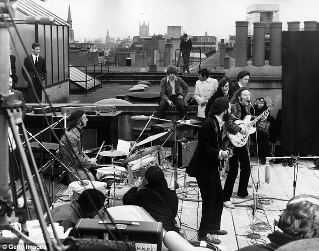 Staggering: British rock group the Beatles performing their last live public concert on the rooftop of the Apple Organization building for director Michael Lindsey-Hogg's film documentary, 'Let It Be,' on Savile Row, London, England