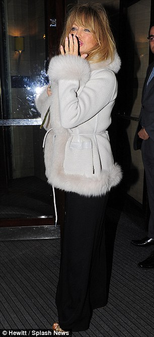 Chic exit: Goldie wore a fur trimmed coat as she left the club at 2am looking as glamorous as ever