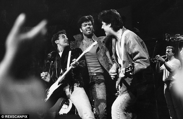 Blast from the past: (L-R) Andrew Ridgley, George Michael and David Austin from Wham! on stage in 1986