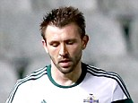 Off you go: Northern Ireland's Gareth McAuley is sent off for a challenge on Cyprus' Dimitris Christofi