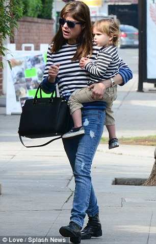 Matchy-matchy! Blair paired her breton stripes with distressed jeans and boots, meanwhile Arthur was dressed in camel-coloured pants and sneakers