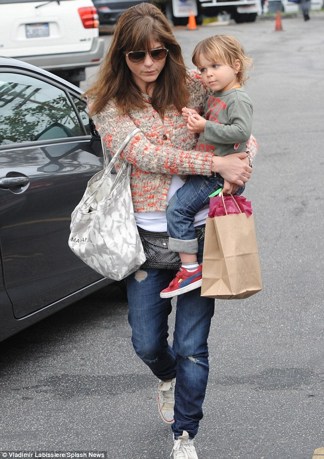 Relaxed day: Selma Blair hip-carried her son Arthur as they left a farmers market in Los Angeles on Sunday
