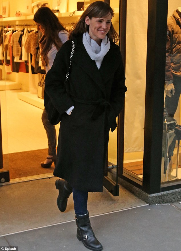 Smiling shopper: The retail therapy seemed to be working as the actress smiled upon leaving some of the posh shops