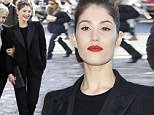 Gemma Arterton does androgynous chic in a stylish black trouser suit as she leads the celebrities at Louis Vuitton's PFW show