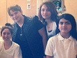 Making dad proud! Prince, Paris and Blanket Jackson pose with a sick patient during visit to a children's hospital