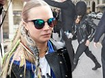 Tuesday, Mar 04 20149AM 4°C12PM9°C5-Day Forecast The hooded Hollywood star: Michelle Rodriguez comes over all shy as she and Cara Delevingne return to Parisian hotel