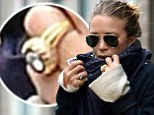 Well that confirms it! Newly engaged Mary-Kate Olsen steps out wearing a giant diamond her ring finger