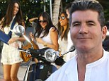 Play nicely girls: Simon Cowell's ex Terri Seymour sports broken arm on day out with former flame and his harem...including girlfriend Lauren Silverman