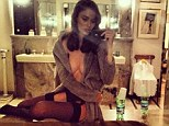 Is this her sexiest selfie yet? Topless Nicole Trunfio poses in a marble bathroom wearing a pair of suspenders and silk stockings