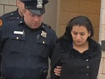 Santos Elena Ruiz Solano leaves court in handcuffs after pleading not guilty to murder charges.